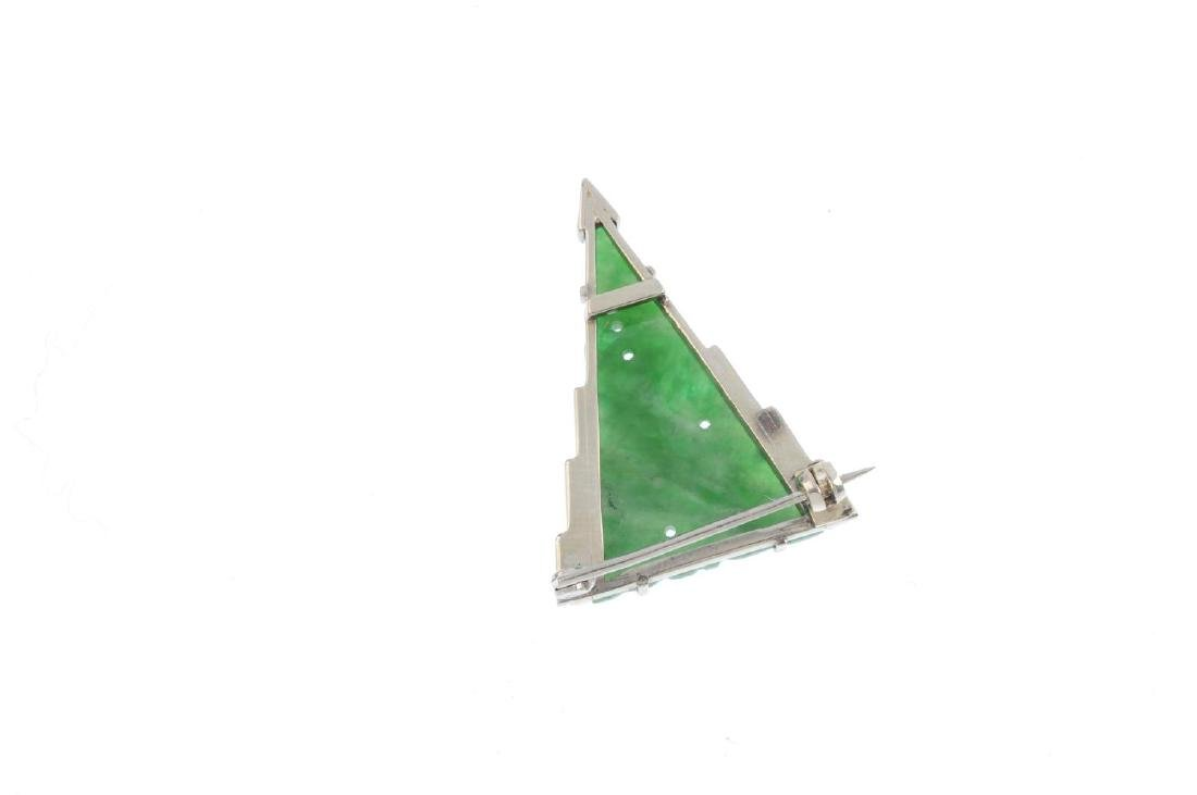 A jade brooch. The triangular jadeite panel, carved to - 2