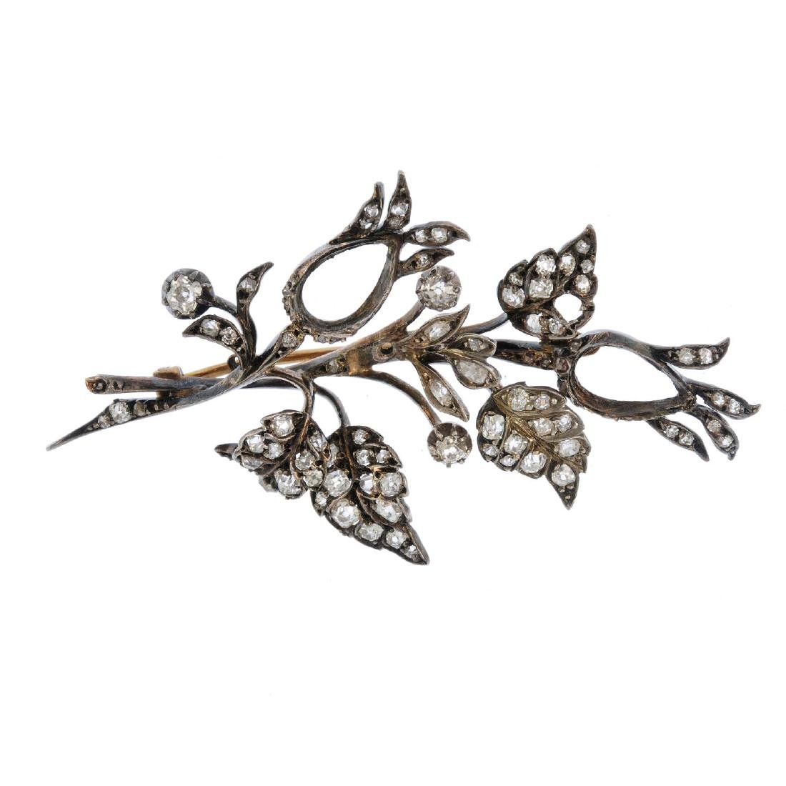 A mid Victorian silver and gold diamond set brooch