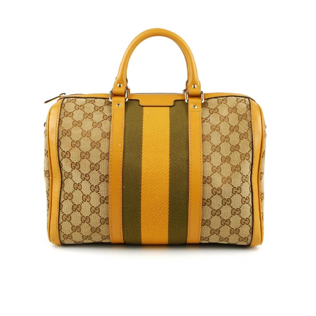 (11907) Two designer handbags. To include a Gucci