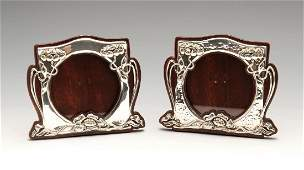 A pair of similarly matched Art Nouveau silver mounted