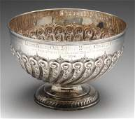 A late Victorian silver footed bowl, embossed with a
