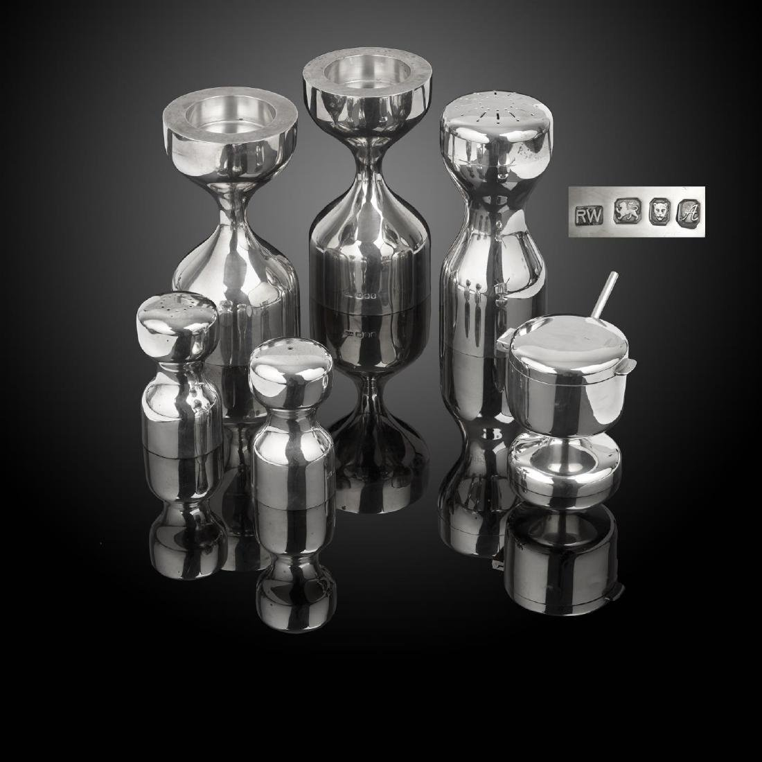 A modern condiment set, caster and pair of candlesticks