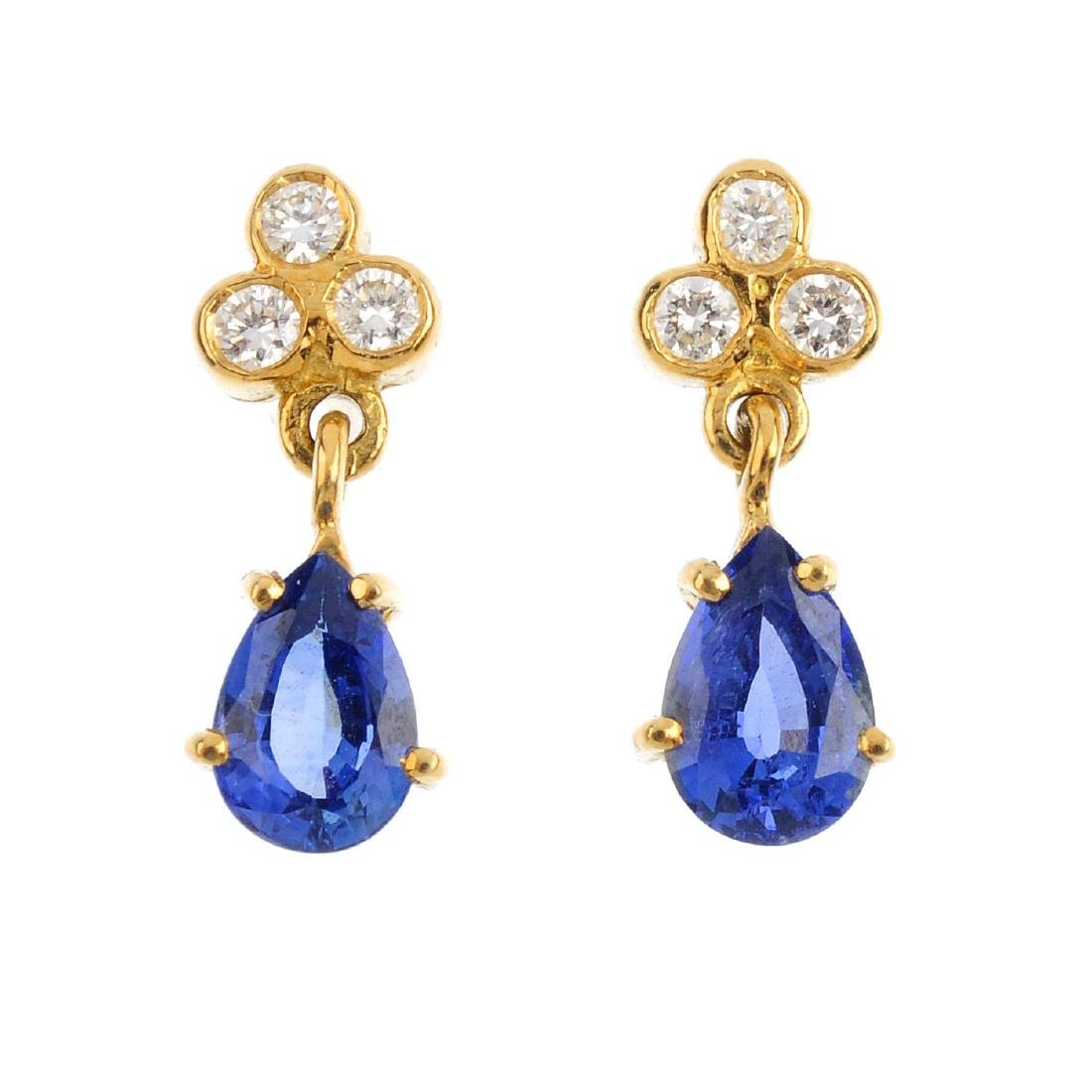 A pair of 18ct gold diamond and sapphire earrings. Each