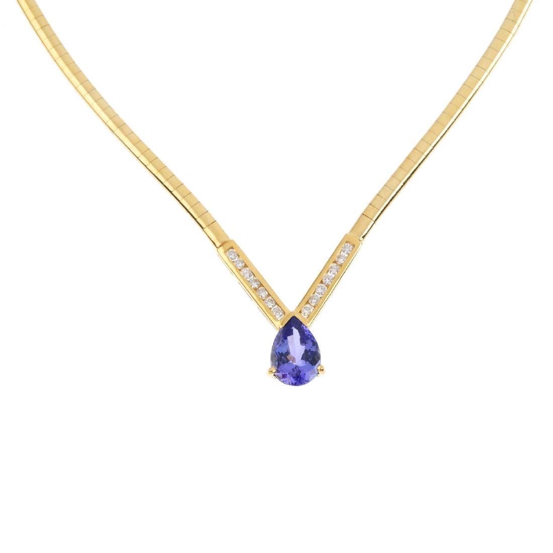 An 18ct gold tanzanite and diamond necklace. The