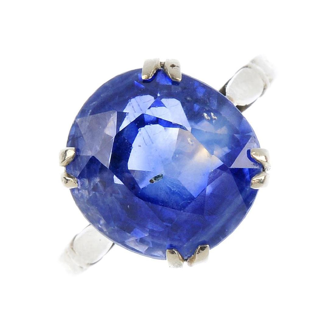 A sapphire single-stone ring. The cushion-shape