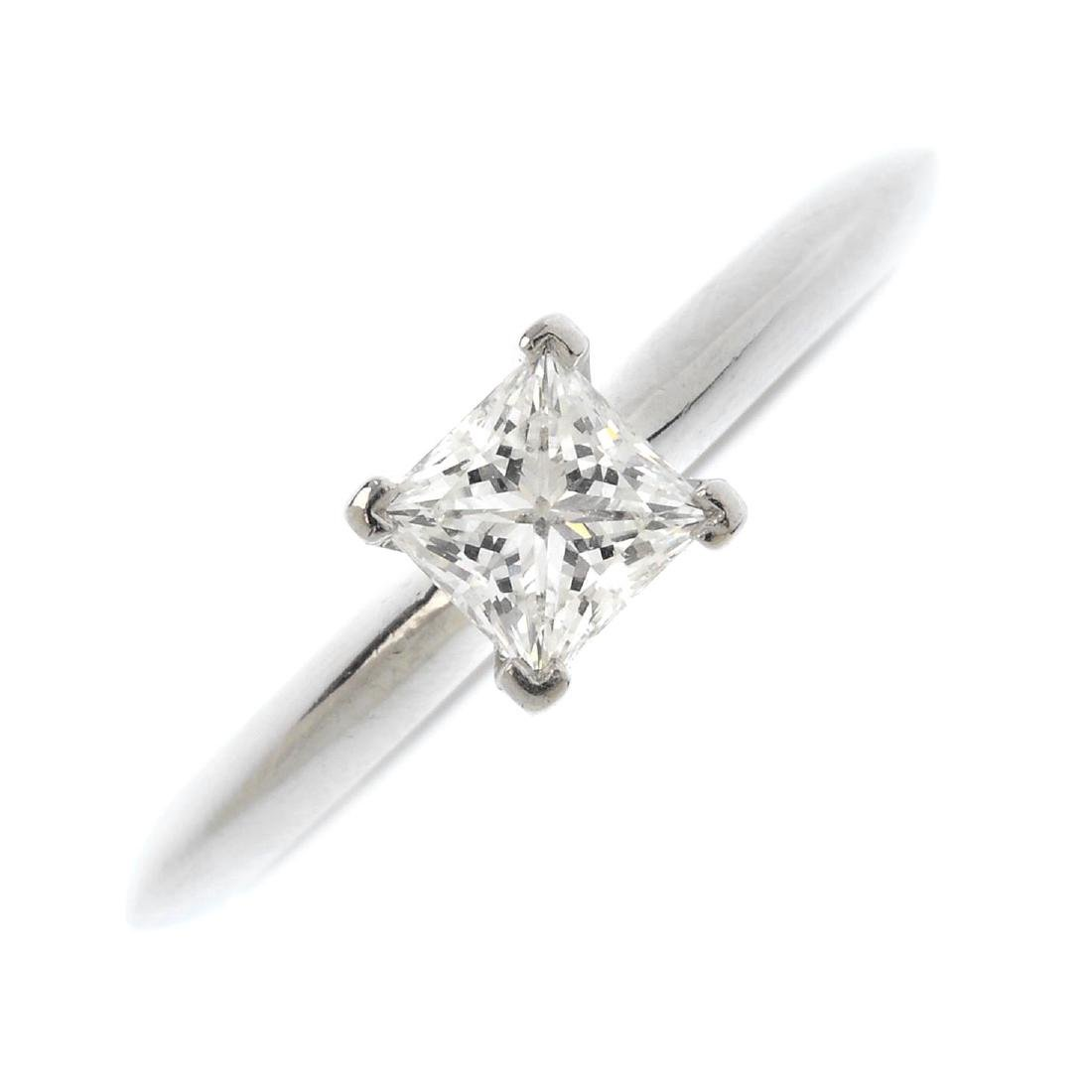TIFFANY & CO. - a platinum diamond single-stone ring.