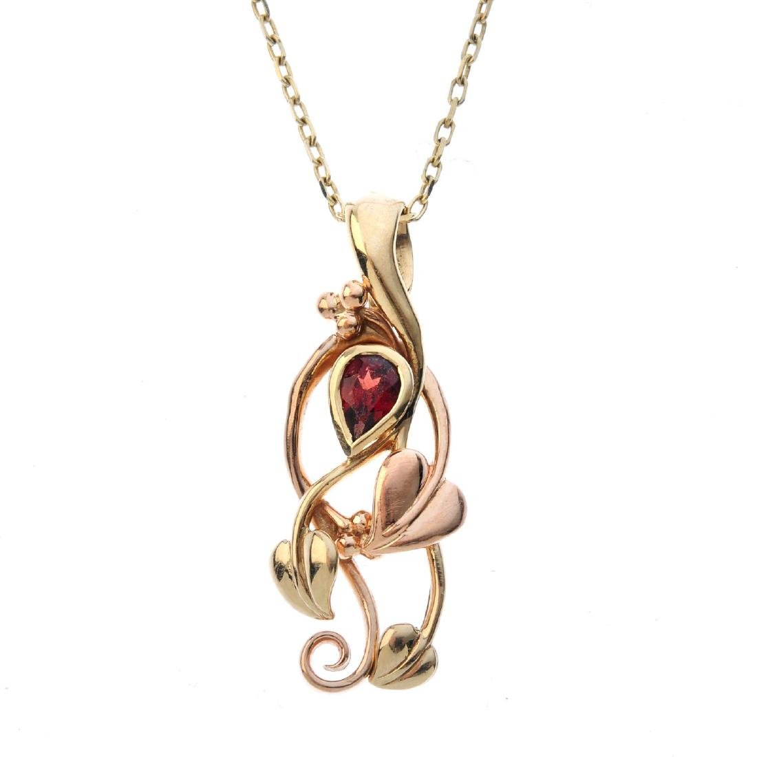 CLOGAU - a 9ct gold garnet pendant. Of bi-colour