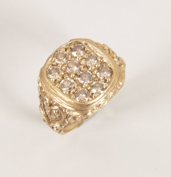 16: A gentleman's 9ct gold cushion top signet ring pave