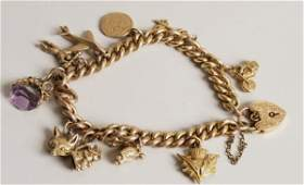 147: 9ct gold solid curb link charm bracelet with ten c