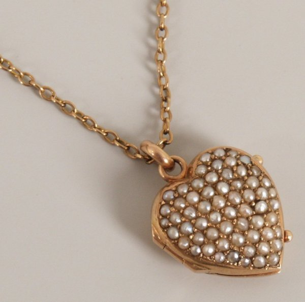 729: Edwardian seed pearl heart shaped locket with fron