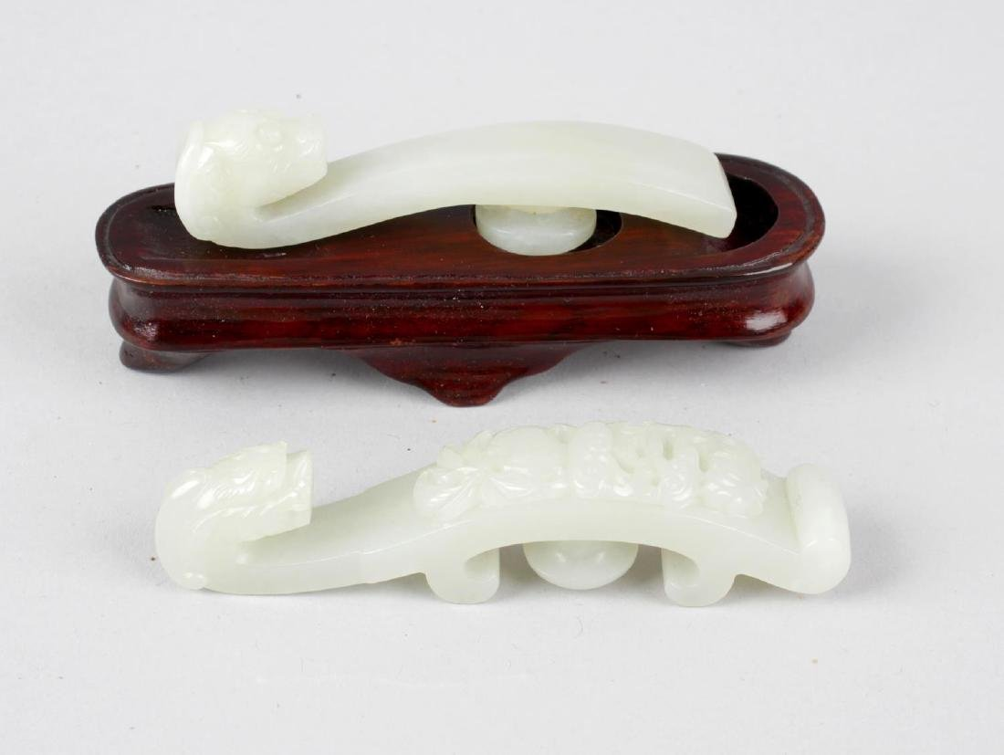 Two Chinese jade belt hooks, the first example with