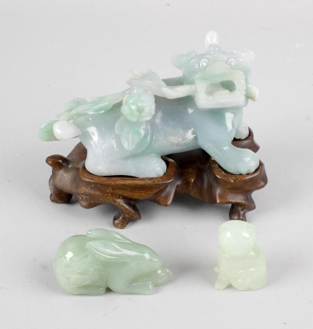 A group of three carved jade animals, the first example