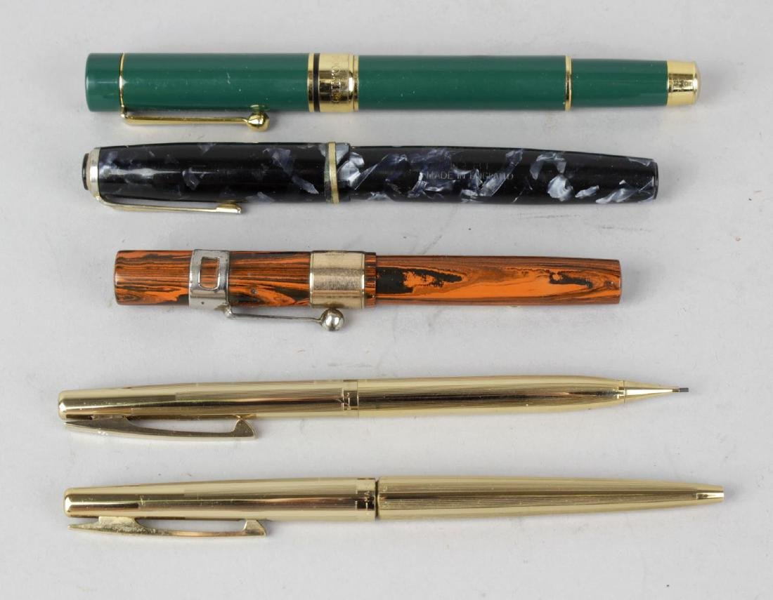 A group of assorted pens. Comprising: a Waterman's
