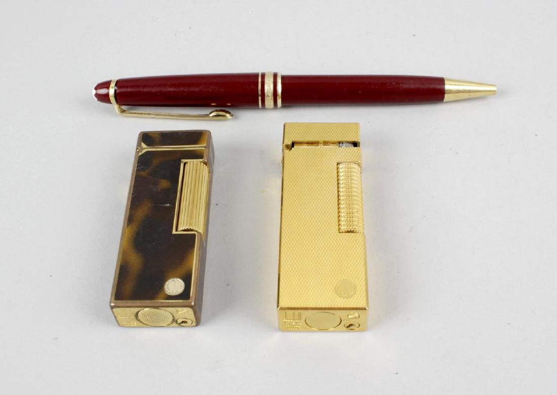 Two Dunhill lighters, each of rectangular form, the