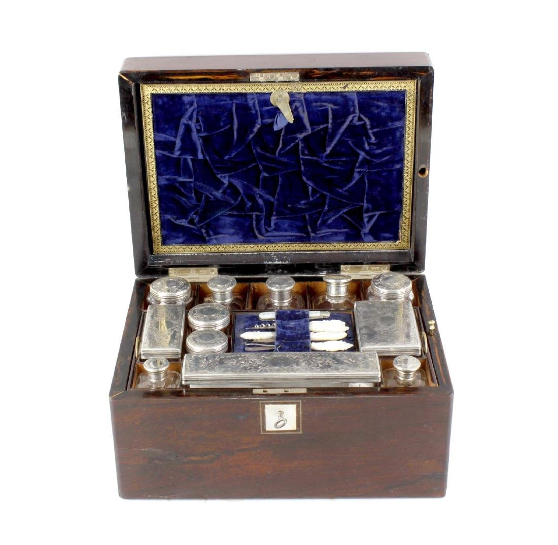 A mid 19th century rosewood travelling case, of