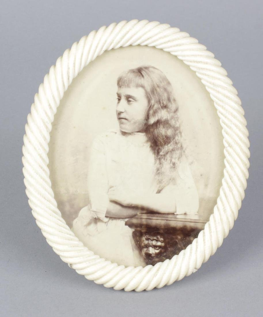 A 19th century carved ivory oval shaped photograph