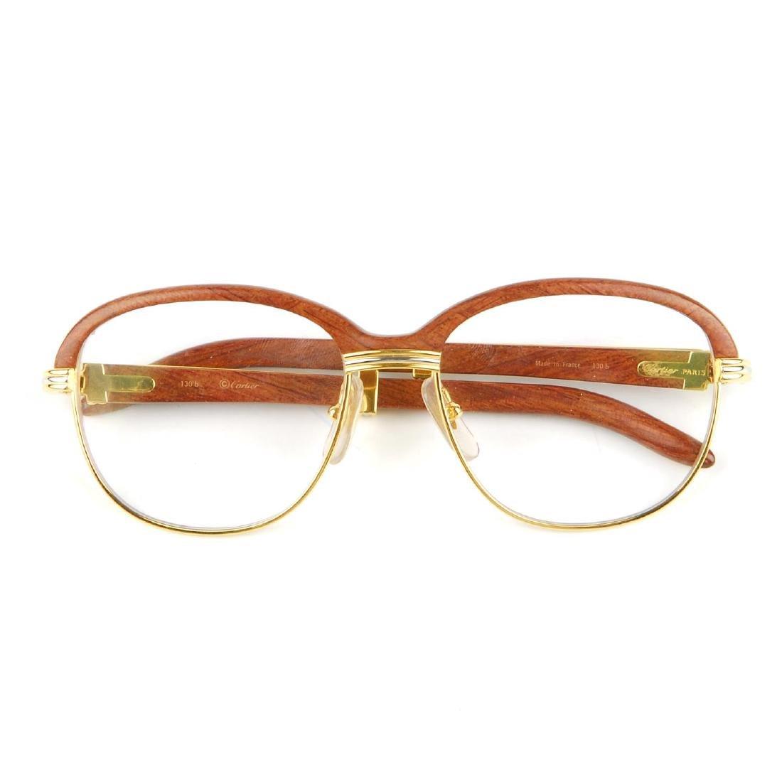 78ef46667f45 Cartier a pair of malmaison palisander rosewood jpg 1100x1100 Cartier  malmaison palisander rosewood