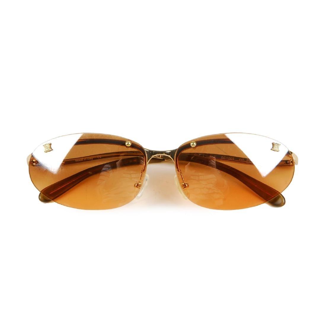 CÉLINE - a pair of rimless sunglasses. Designed with