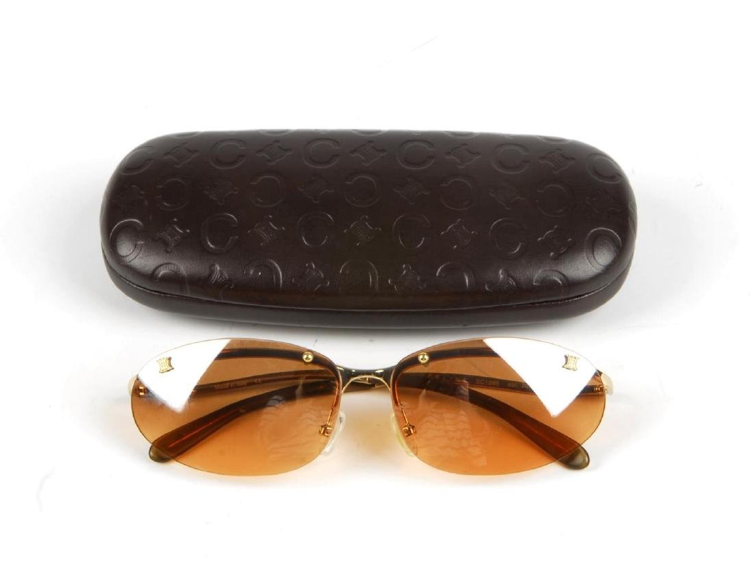 CÉLINE - a pair of rimless sunglasses. Designed with - 2