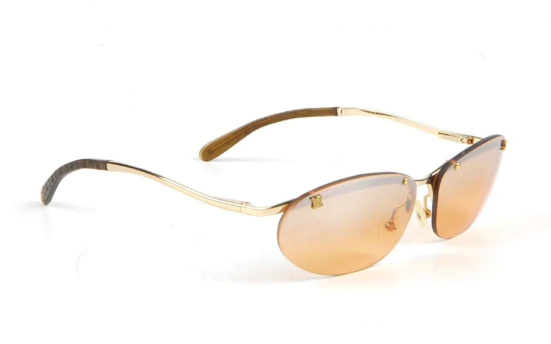 CÉLINE - a pair of rimless sunglasses. Designed with - 4