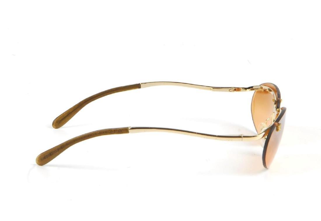 CÉLINE - a pair of rimless sunglasses. Designed with - 5