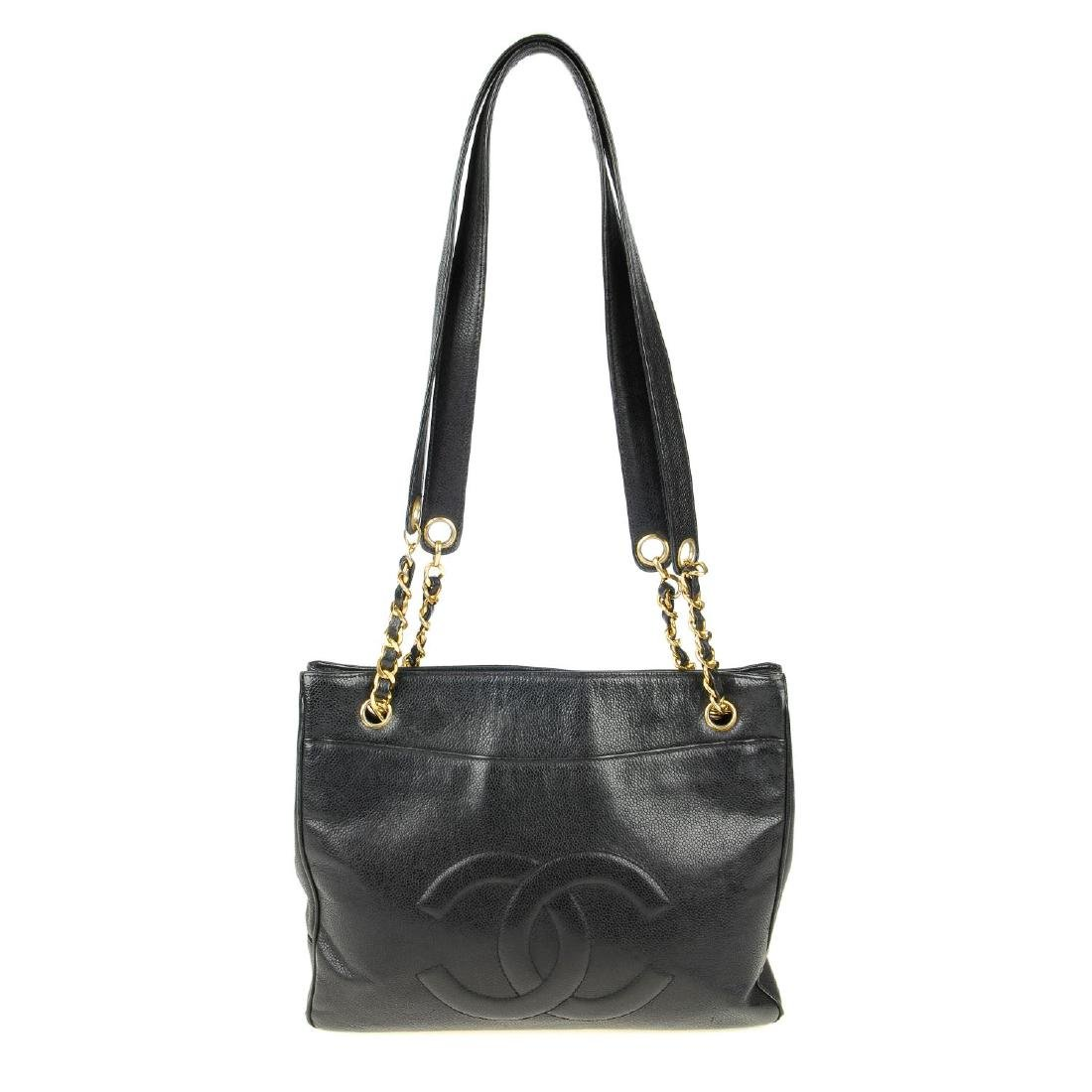 CHANEL - a Caviar leather handbag. The square tote with