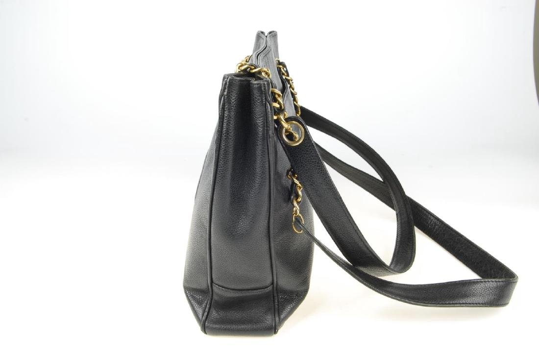 CHANEL - a Caviar leather handbag. The square tote with - 7