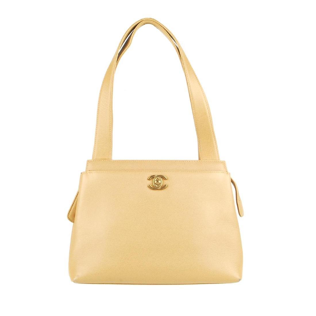 CHANEL - a late 90s small beige Caviar leather handbag.