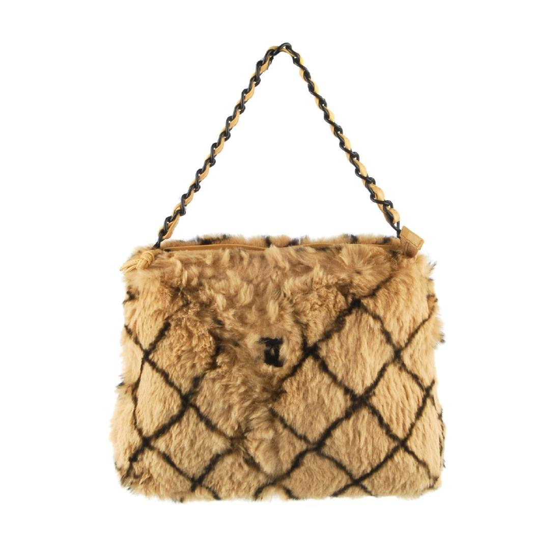 CHANEL - a fur handbag. Designed with a light brown