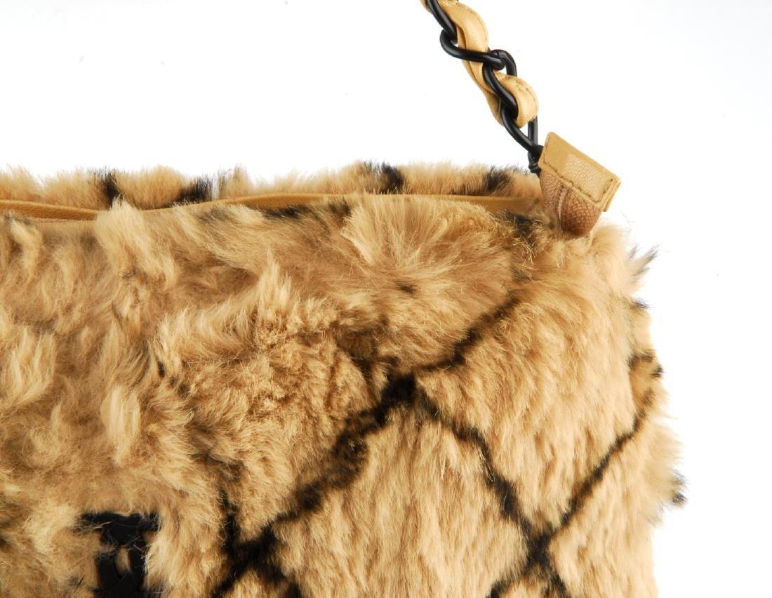 CHANEL - a fur handbag. Designed with a light brown - 2