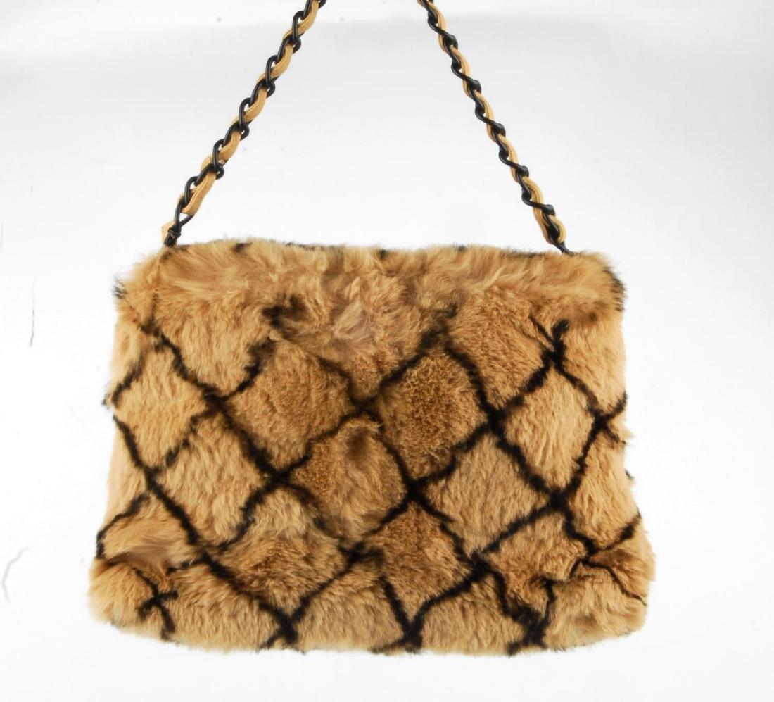 CHANEL - a fur handbag. Designed with a light brown - 4