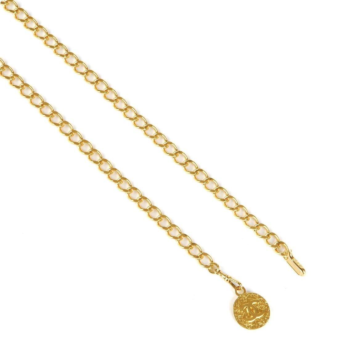 CHANEL - a chain belt. Featuring a gold-tone chain with