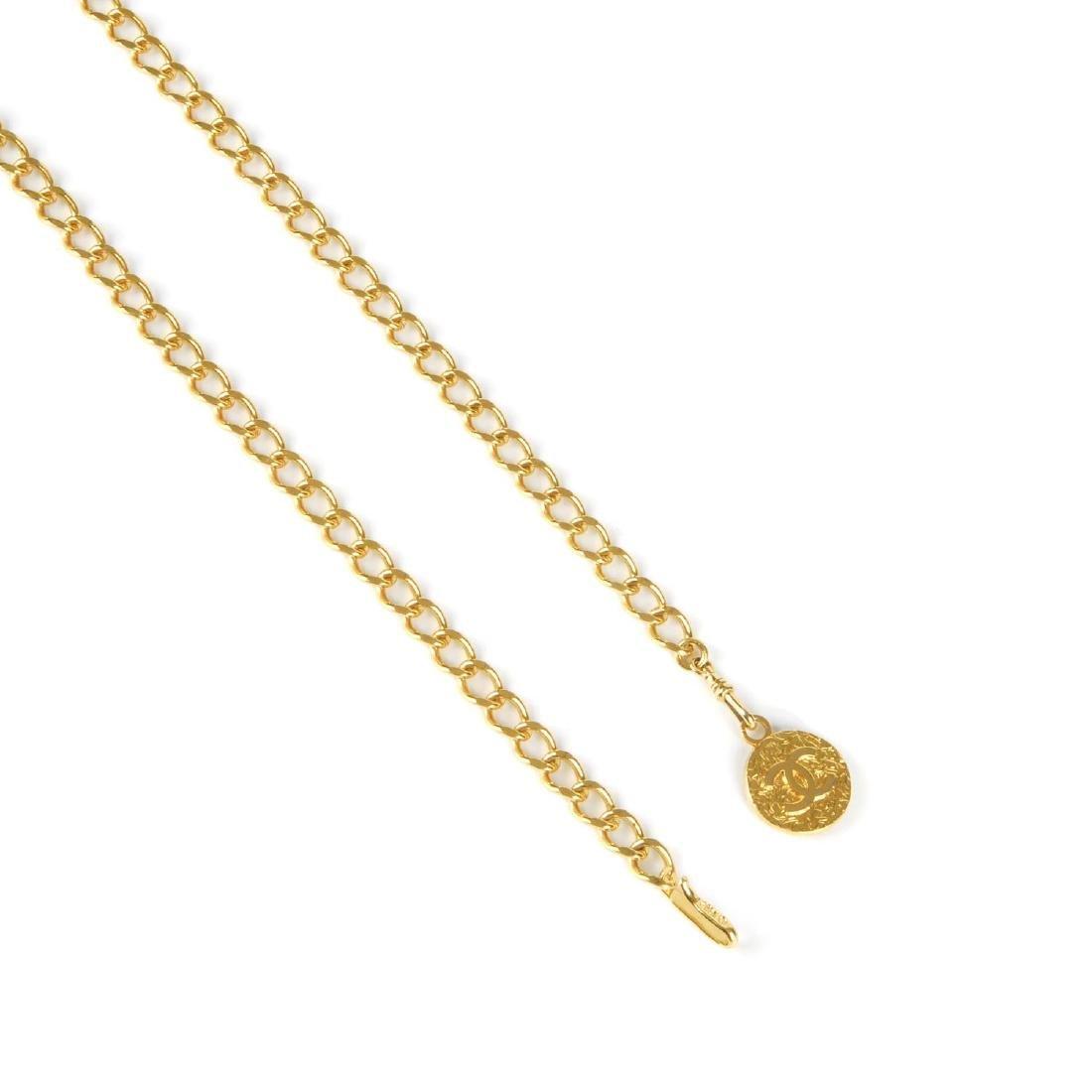 CHANEL - a chain belt. Featuring a gold-tone curb chain