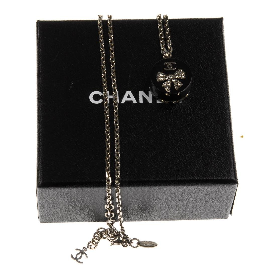 CHANEL - a resin Crystal Bow CC pendant. Designed as - 2