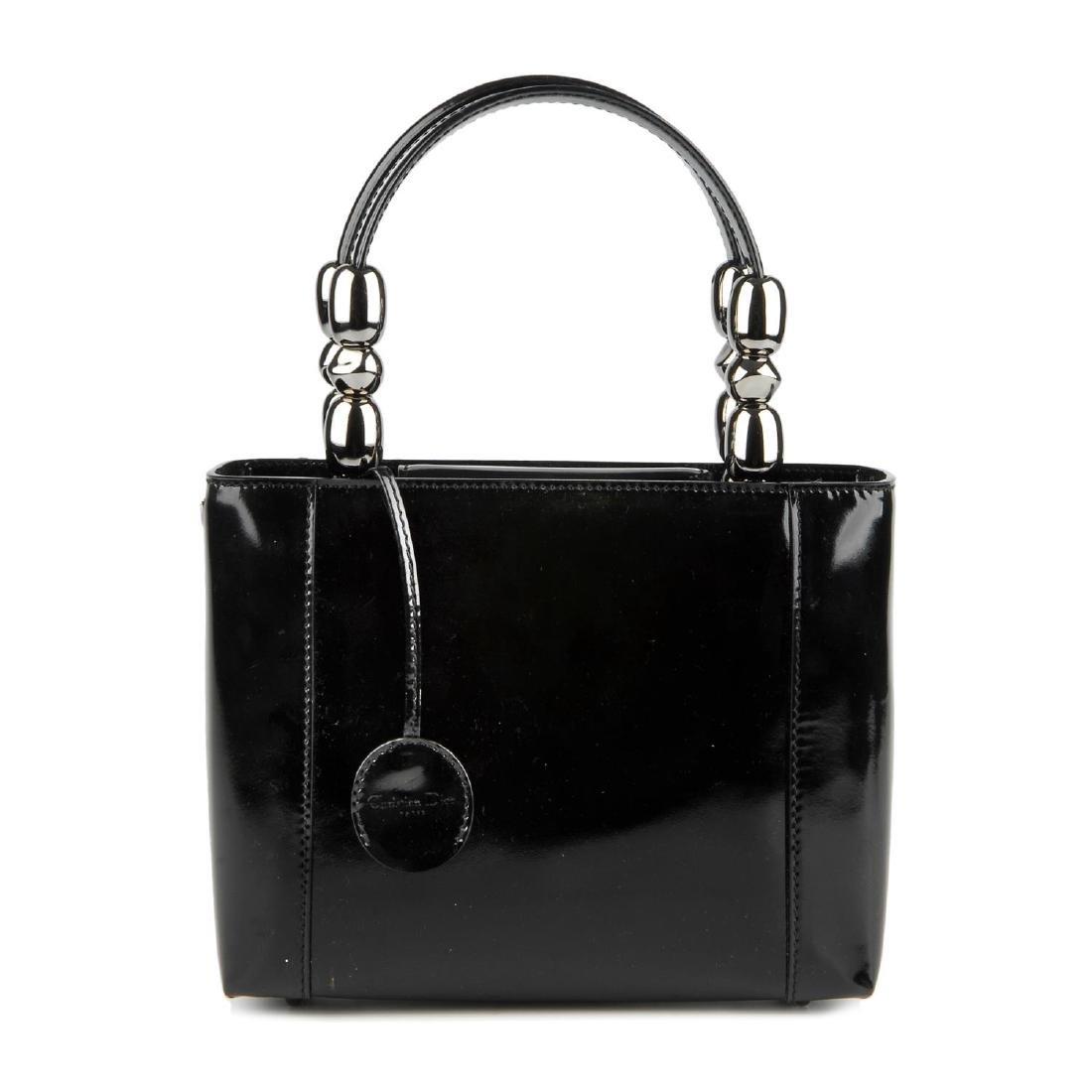 CHRISTIAN DIOR - a patent leather Malice handbag.