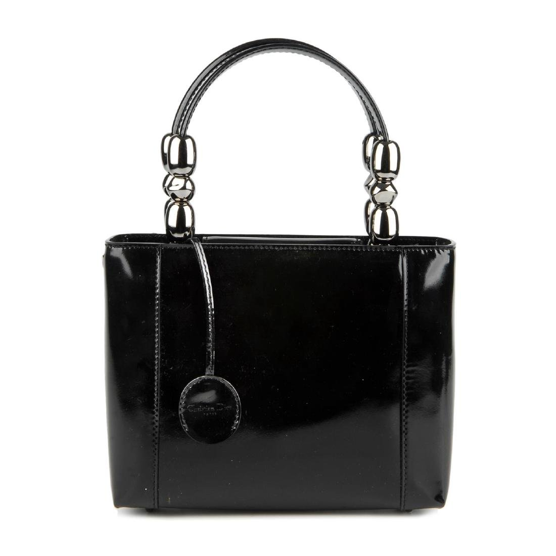 CHRISTIAN DIOR - a patent leather Malice handbag.