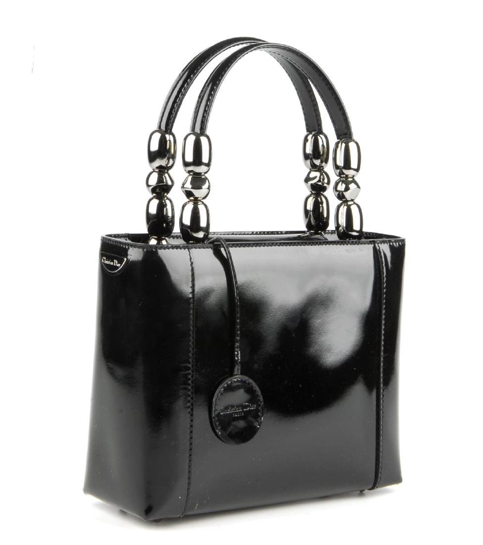 CHRISTIAN DIOR - a patent leather Malice handbag. - 2
