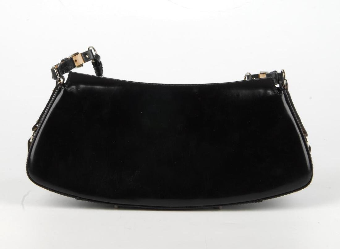 CHRISTIAN DIOR - a black coated leather baguette - 4