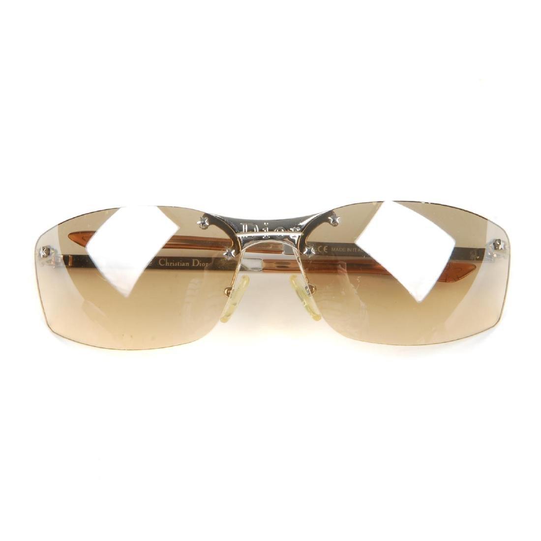 CHRISTIAN DIOR - a pair of rimless sunglasses.