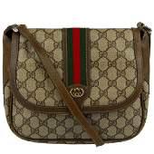 GUCCI - a vintage GG Supreme Web messenger handbag.
