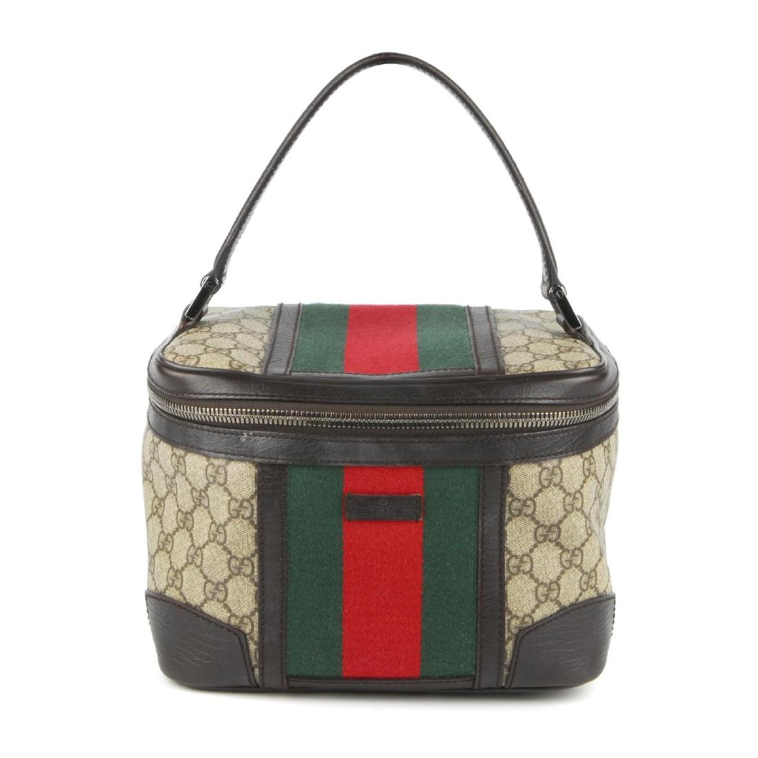 GUCCI - a Supreme Web cosmetics travel bag. Crafted