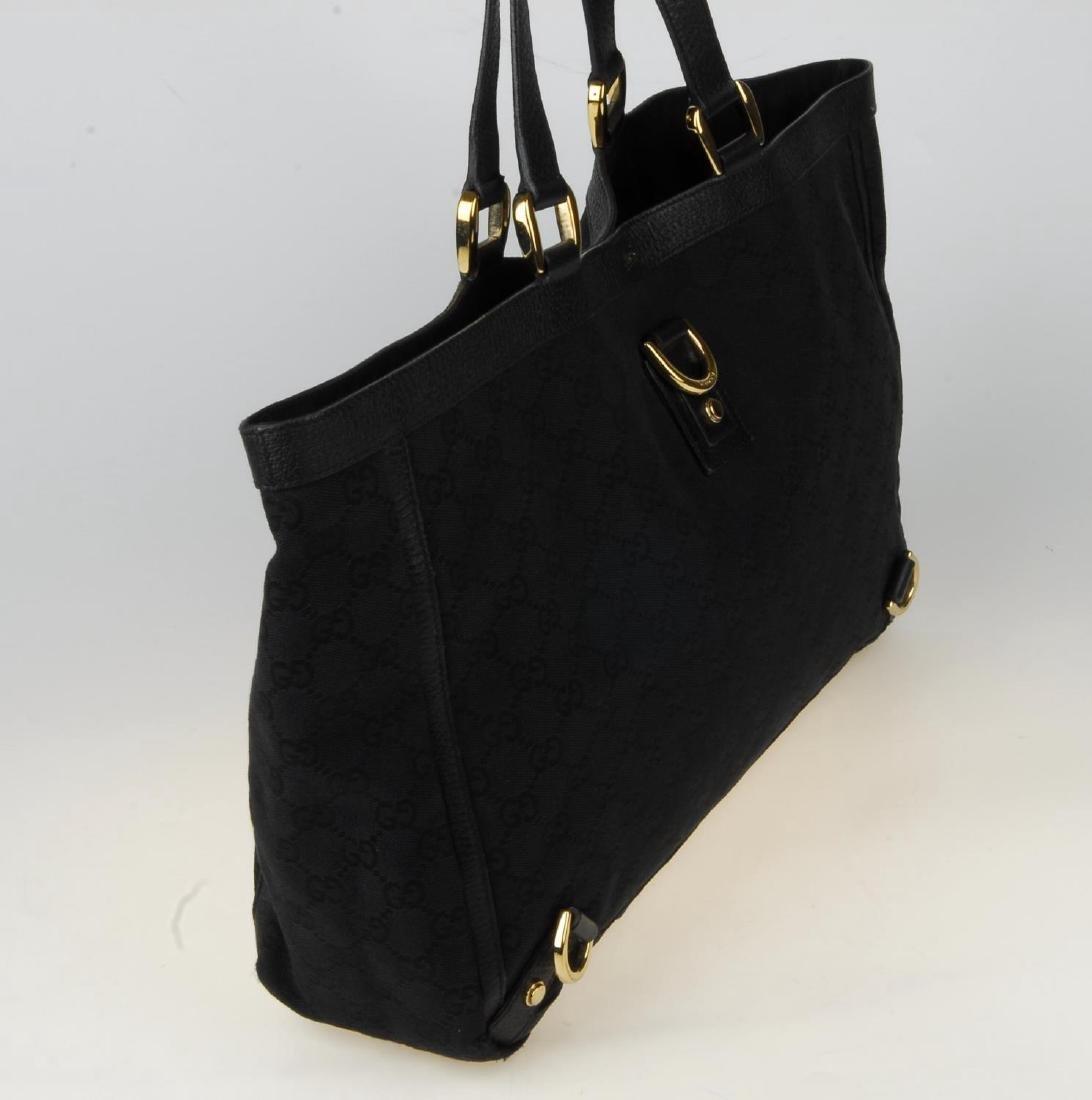 GUCCI - a black Abbey handbag. Crafted from black - 4