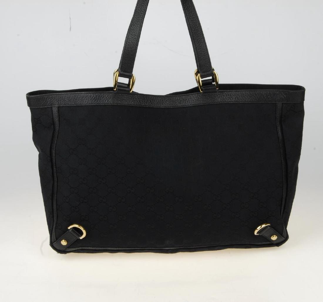 GUCCI - a black Abbey handbag. Crafted from black - 5