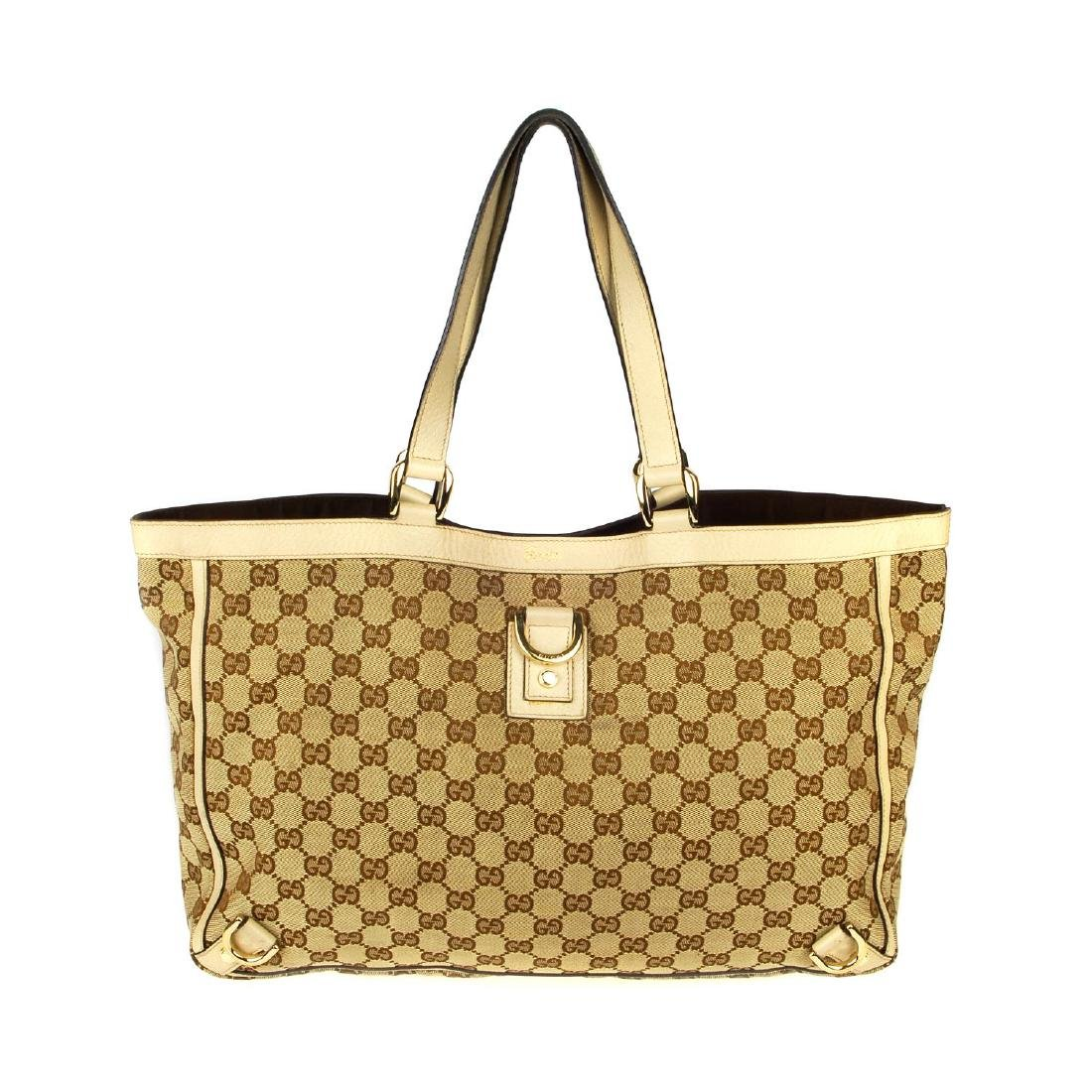 GUCCI - an Abbey handbag. Crafted of maker's GG beige