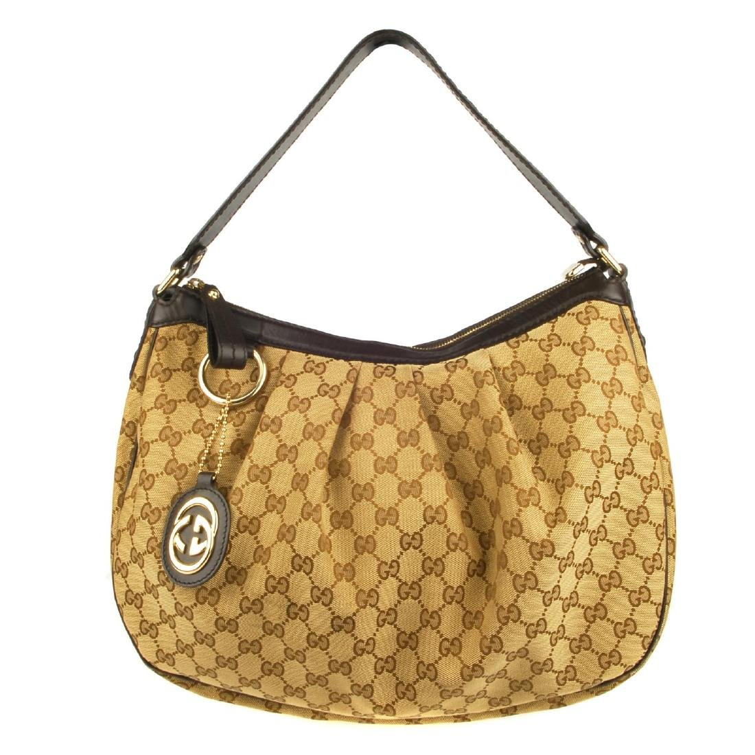 GUCCI - a handbag. Crafted from maker's classic beige