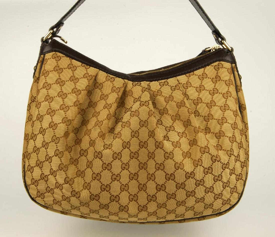 GUCCI - a handbag. Crafted from maker's classic beige - 4