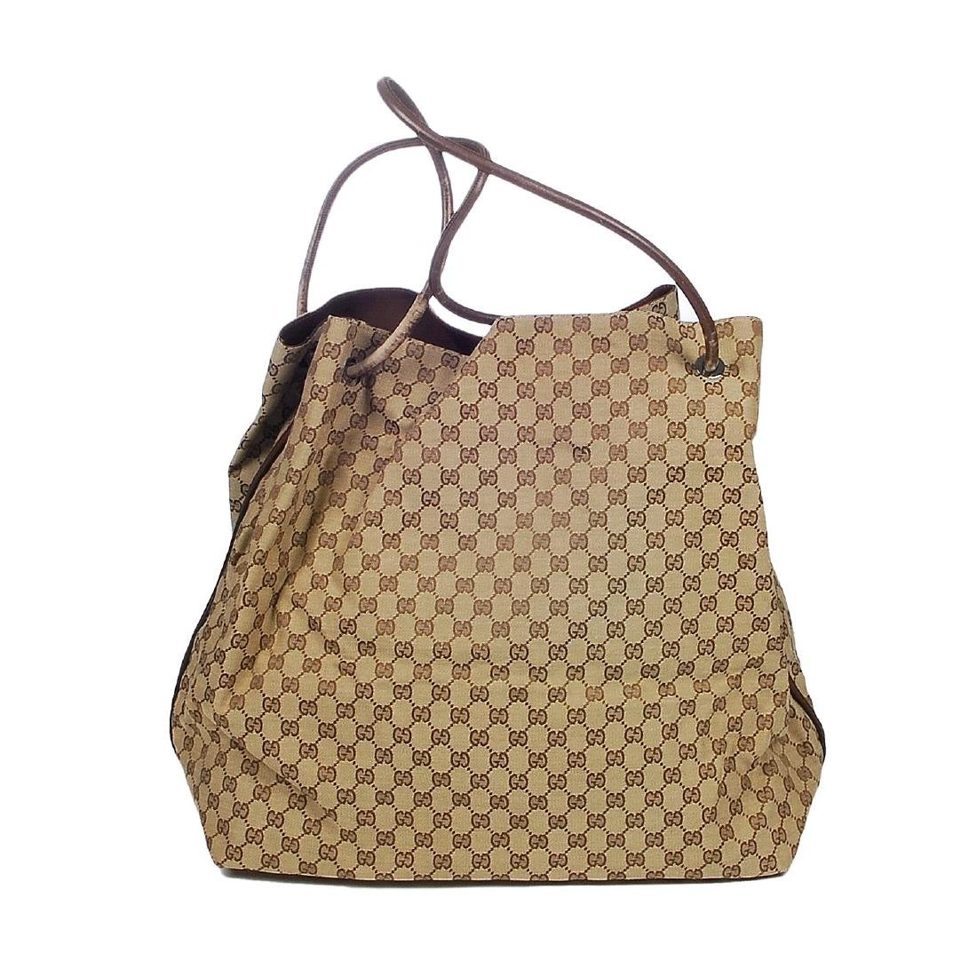GUCCI - a large GG canvas handbag. Crafted from maker's