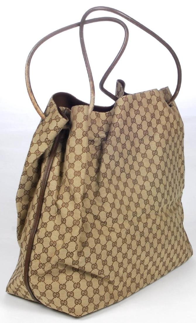 GUCCI - a large GG canvas handbag. Crafted from maker's - 2