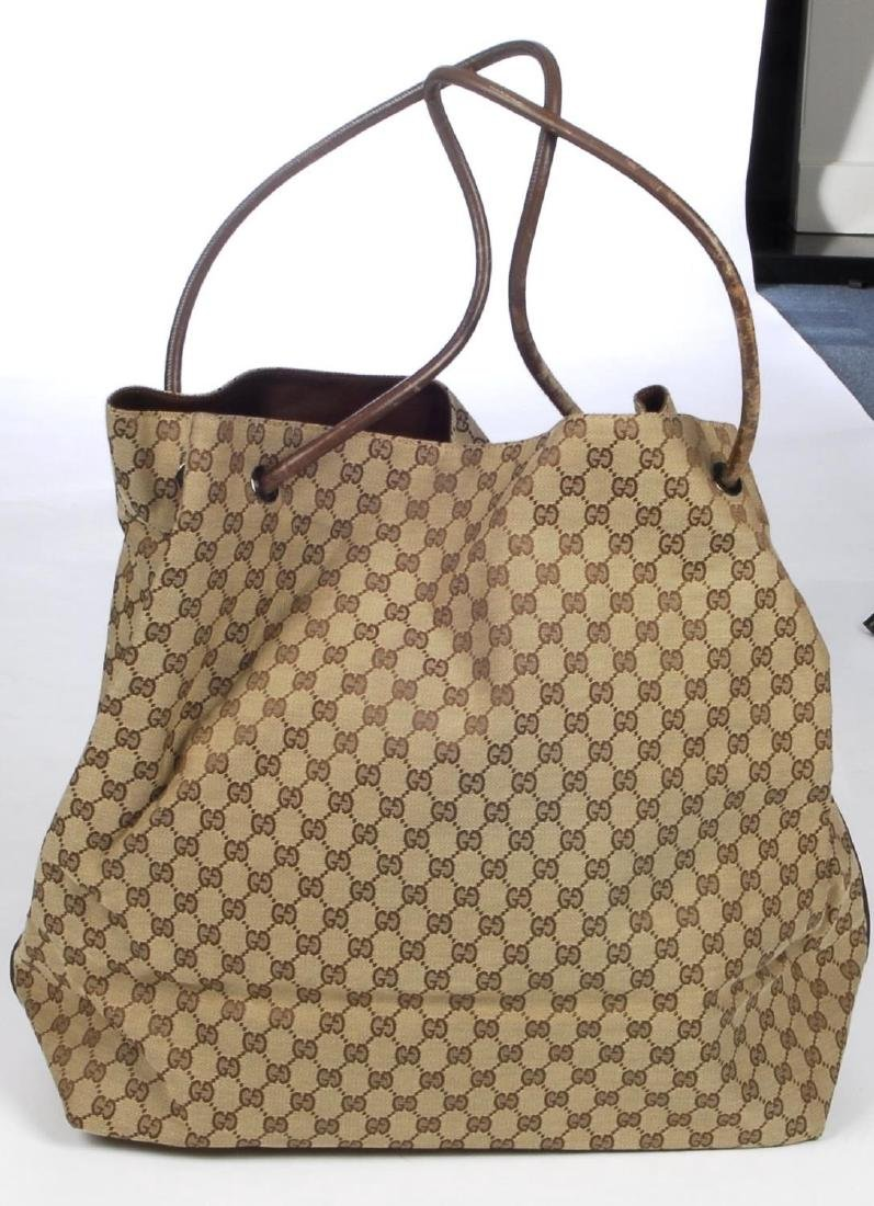 GUCCI - a large GG canvas handbag. Crafted from maker's - 3