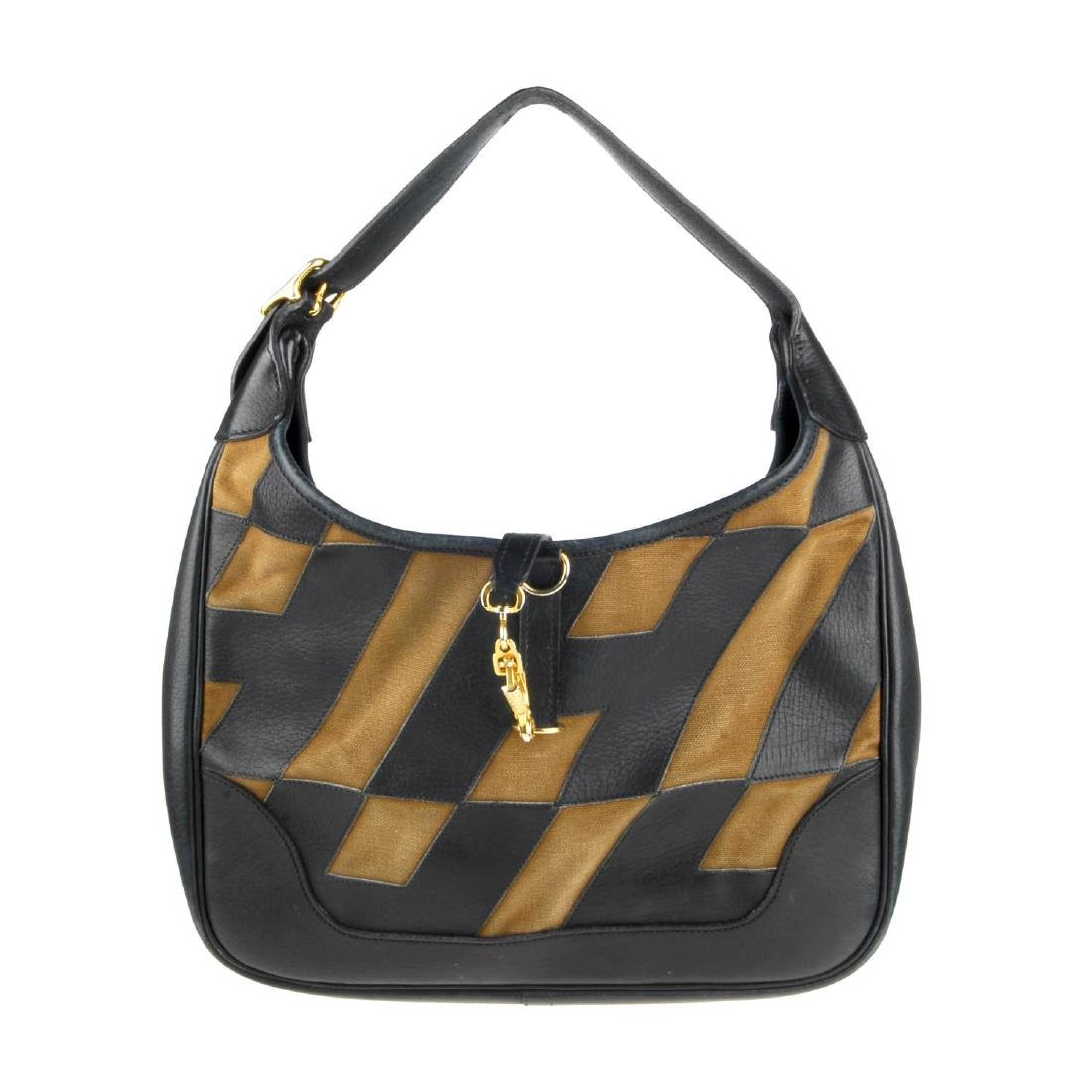 HERMÈS - a Trim handbag. Crafted from brown canvas and